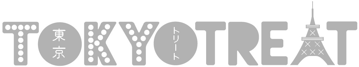 Toykotreat logo gray lettering with contrast dots inside T K and Y and Eiffel Tower symbol for the letter A