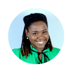 Round headshot profile photo of smiling African American woman wearing mint green shirt