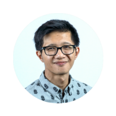 Round head shot profile photo of smiling Asian man with short black hair and glasses